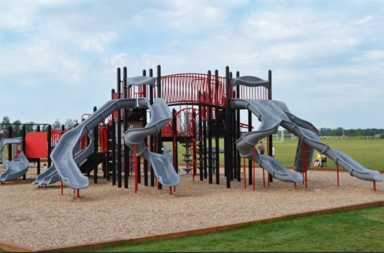 A playground with multiple slides. Installed by PlayQuest in Manitoba.