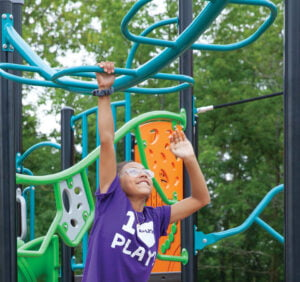 girl climbing play structure